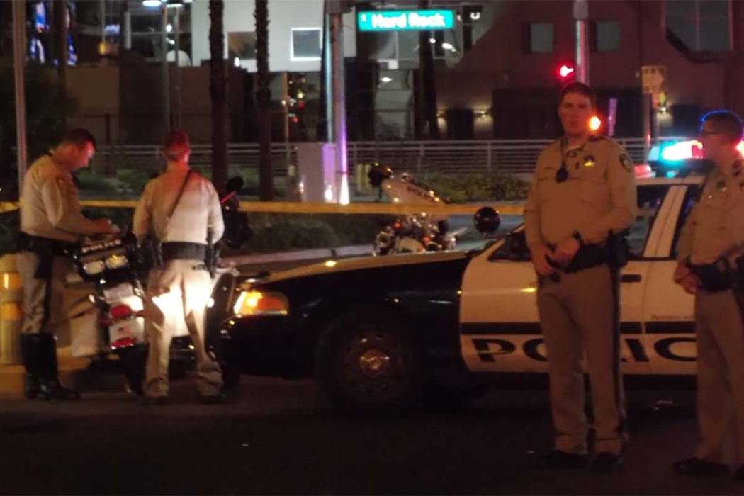 Las Vegas police investigate an accident involving a vehicle and a pedestrian at Paradise Road and East Harmon Avenue. (Max MIchor/Las Vegas Review-Journal)