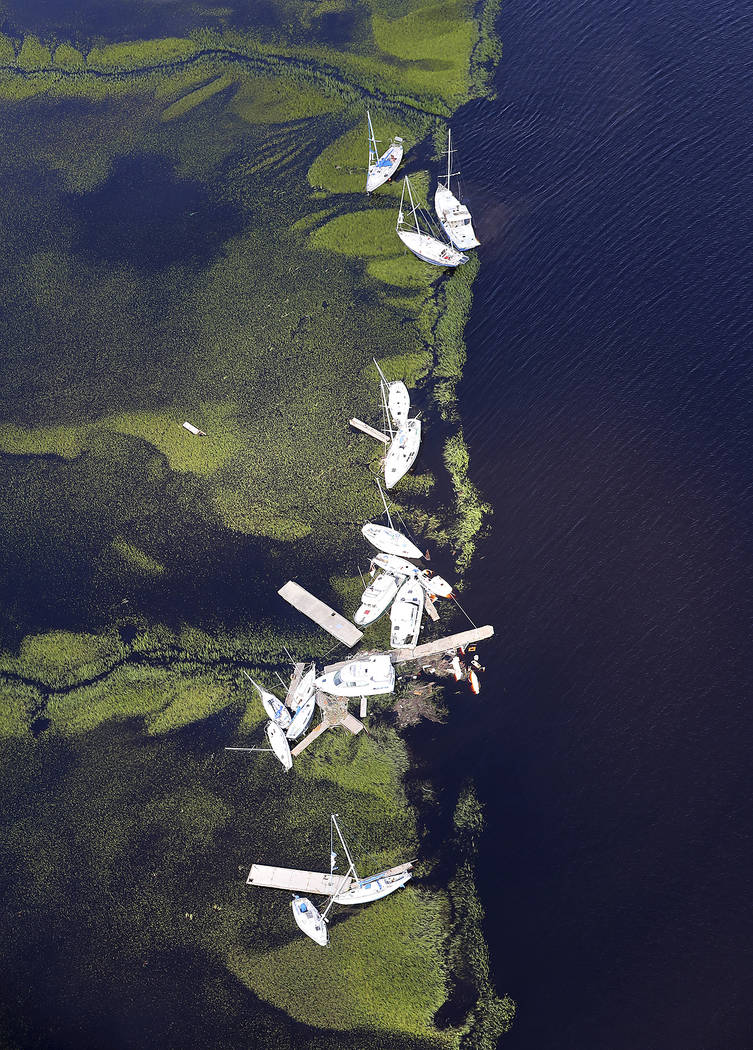 Boats blown away from their docks sit in the marsh after Hurricane Irma on Tuesday, Sept. 12, 2017, at St. Marys on the Georgia coast. (Curtis Compton/Atlanta Journal-Constitution via AP)