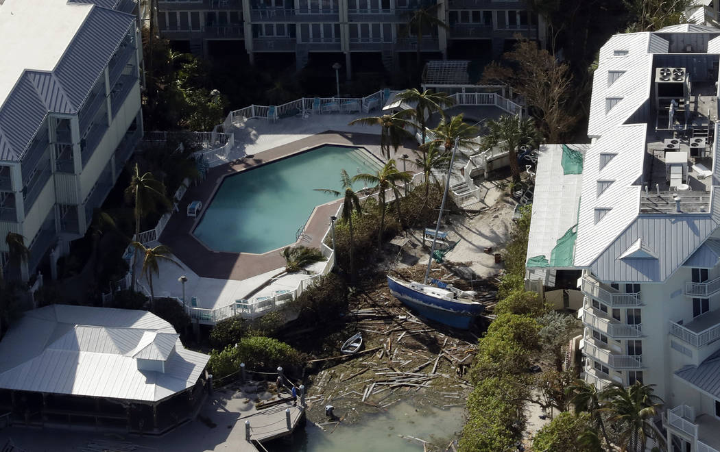 A sailboat is pushed up between two buildings in the aftermath of Hurricane Irma on Tuesday, Sept. 12, 2017, in Key West, Fla. (AP Photo/Chris O'Meara)