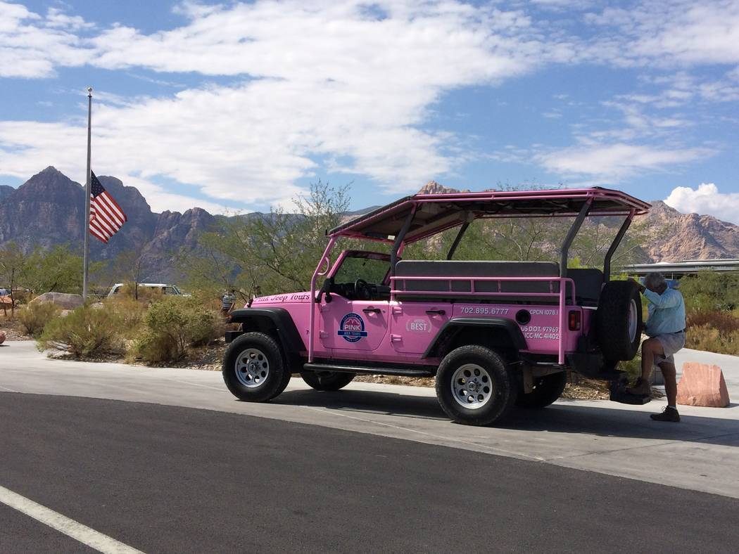 Commercial tour groups such as Pink Jeep Tours, seen here outside the visitor center at Red Rock Sept. 10, 2017, will still be charged $5 per person but with the proposed fee increase, they will a ...