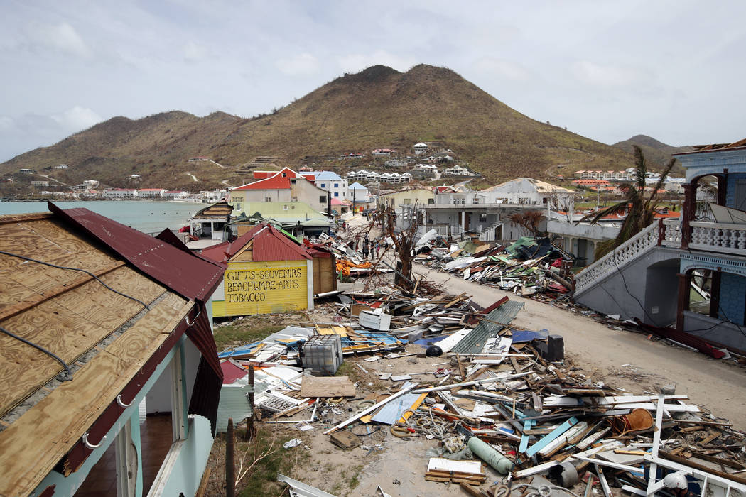 View of the partially buildings destroyed by Irma during the visit of France's President Emmanuel Macron in the French Caribbean islands of St. Martin, Tuesday, Sept. 12, 2017. Macron is in the Fr ...