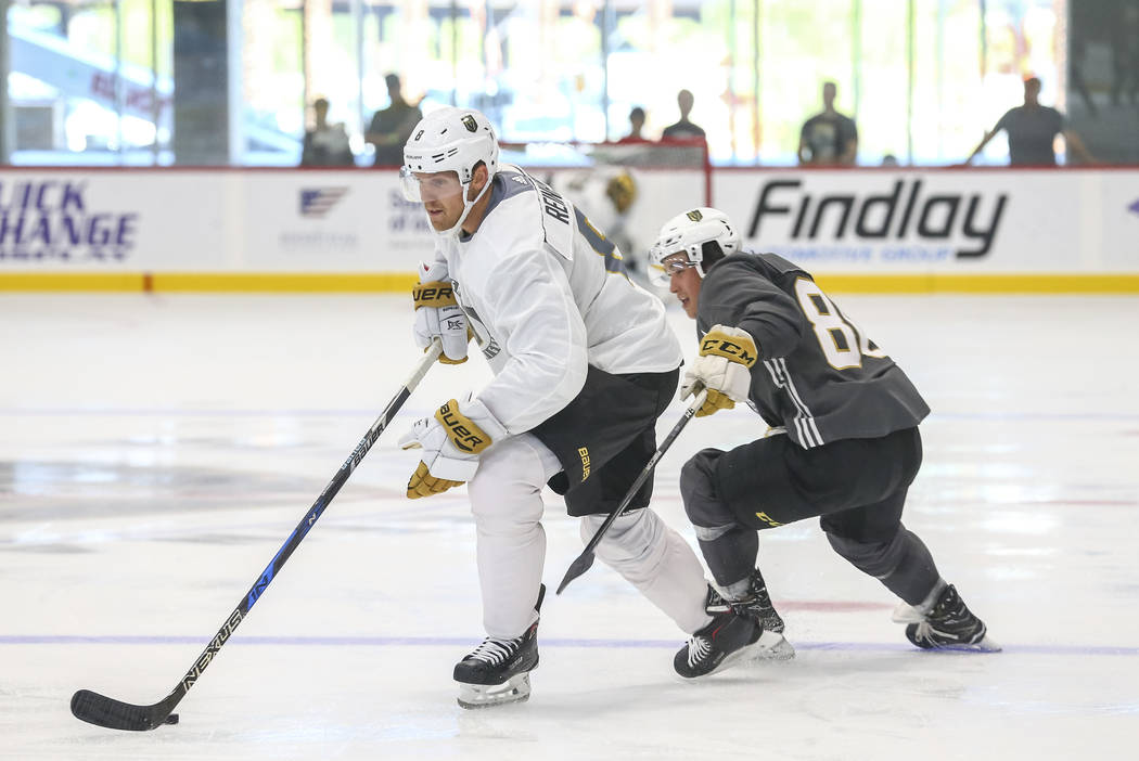 Vegas Golden Knights' Griffin Reinhart, left, is chased by Tyler Wong in a scrimmage game during team practice at the City National Arena on Friday, Sept. 15, 2017, in Las Vegas. Richard Brian Las ...