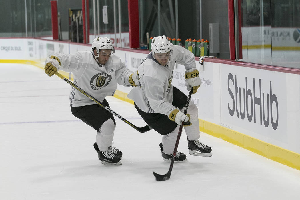 Vegas Golden Knights forward Nick Suzuki, right, is pressured by teammate Jayden Halbgewachs during the final day of rookie camp practice at City National Arena on Monday, Sept. 11, 2017, in Las V ...