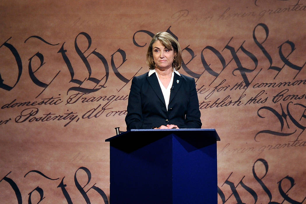Nevada secretary of state candidate Kate Marshall stands at her podium during a debate against her opponent Barbara Cegavske at the Las Vegas PBS television studio on Friday, Oct. 3, 2014. (David  ...