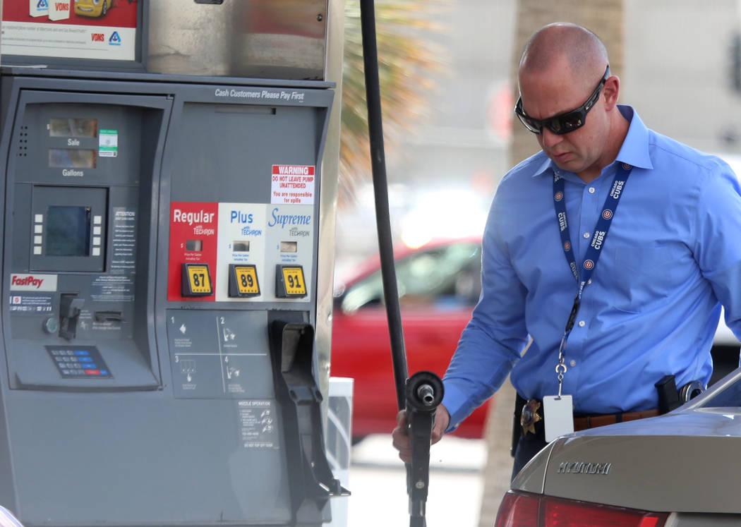 A customer pumps gas at Chevron on Bonanza Road on Wednesday Sept. 13, 2017, in Las Vegas.  Bizuayehu Tesfaye Las Vegas Review-Journal @bizutesfaye