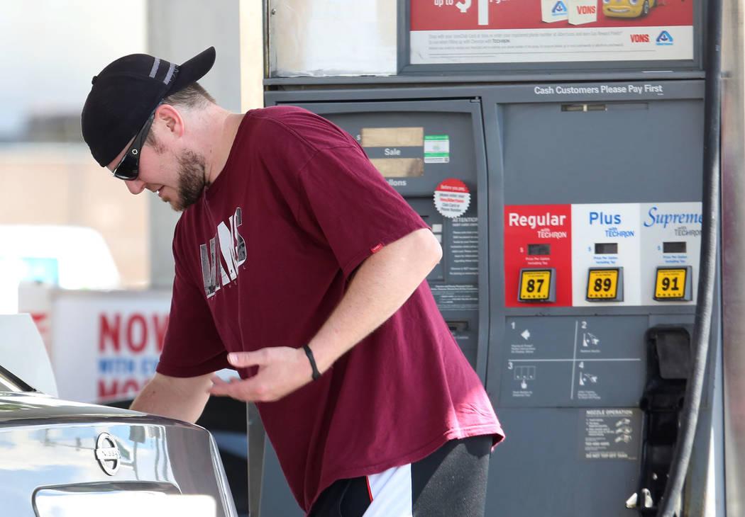 A customer locks his fuel tank cap after pumping gas at Chevron on Bonanza Road on Wednesday Sept. 13, 2017, in Las Vegas.  Bizuayehu Tesfaye Las Vegas Review-Journal @bizutesfaye