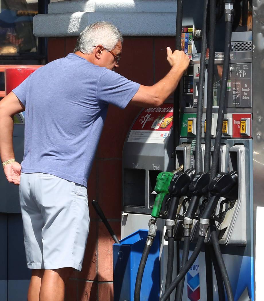 A customer checks his transaction after pumping gas at Chevron on Rampart Boulevard on Wednesday Sept. 13, 2017, in Las Vegas.  Bizuayehu Tesfaye Las Vegas Review-Journal @bizutesfaye