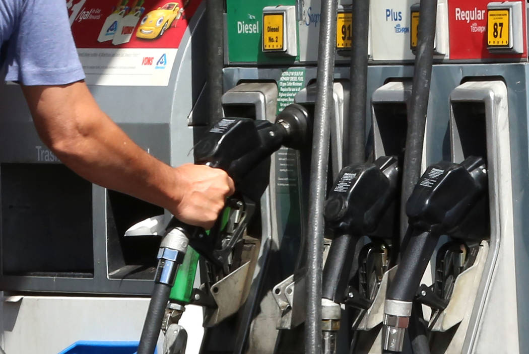 A customer pumps gas at Chevron on Rampart Boulevard on Wednesday Sept. 13, 2017, in Las Vegas.  Bizuayehu Tesfaye Las Vegas Review-Journal @bizutesfaye