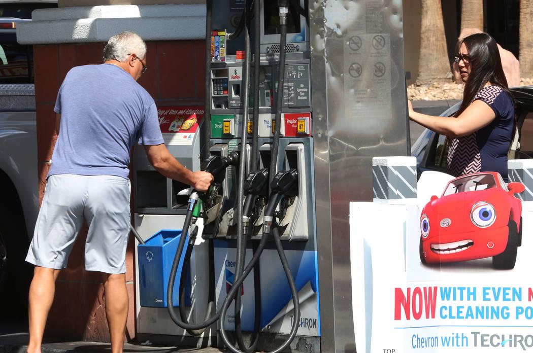 Customers pump gas at Chevron on Rampart  Boulevard on Wednesday Sept. 13, 2017, in Las Vegas.  Bizuayehu Tesfaye Las Vegas Review-Journal @bizutesfaye