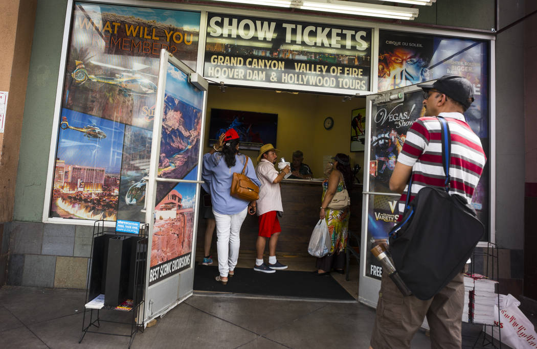 Customers walk into Las Vegas Tickets and Tours near Convention Center Drive along the north Strip area in Las Vegas on Wednesday, Sept. 13, 2017. Chase Stevens Las Vegas Review-Journal @csstevens ...