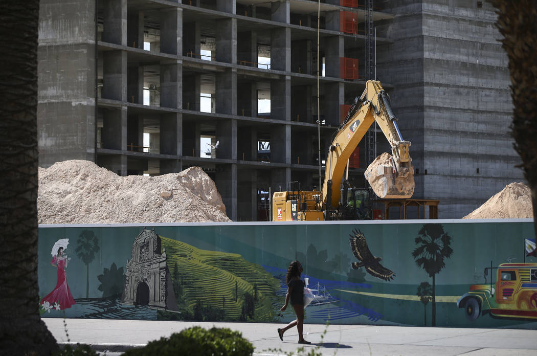 Construction continues at Resorts World Las Vegas as pedestrians pass by along the north Strip area in Las Vegas on Wednesday, Sept. 13, 2017. Chase Stevens Las Vegas Review-Journal @csstevensphoto