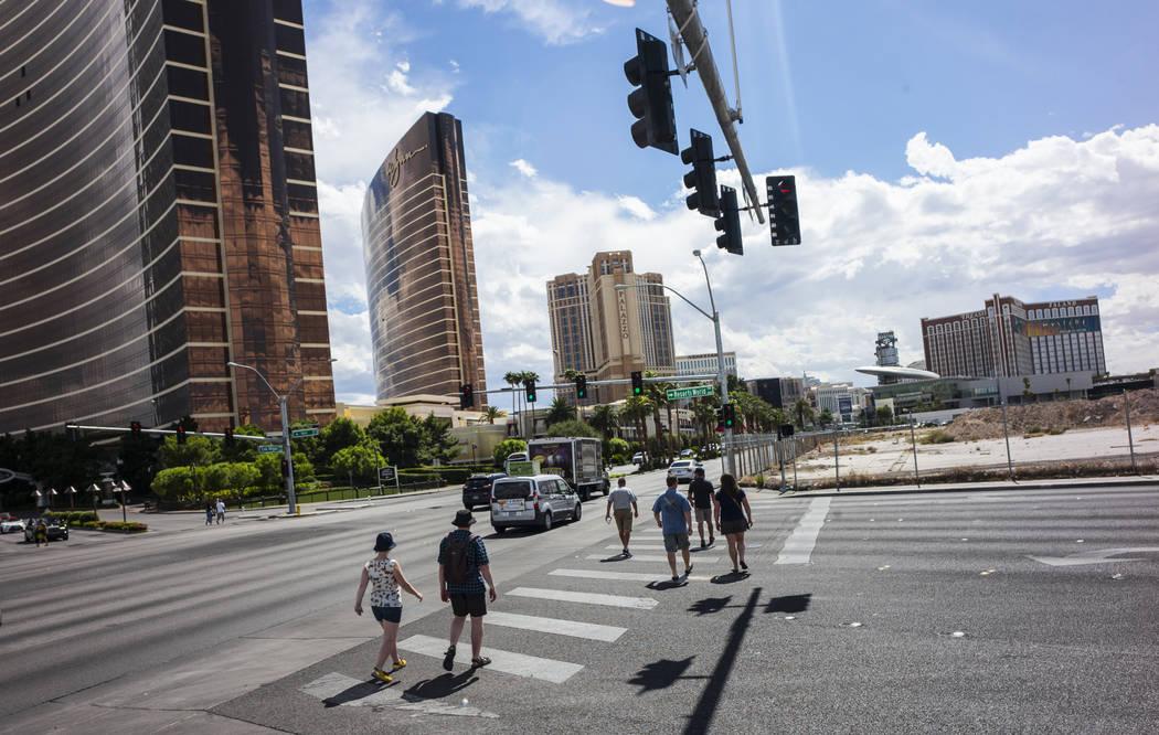 Pedestrians walk along the north Strip near planned site for the Alon casino-resort, upper right, in Las Vegas on Wednesday, Sept. 13, 2017. Chase Stevens Las Vegas Review-Journal @csstevensphoto
