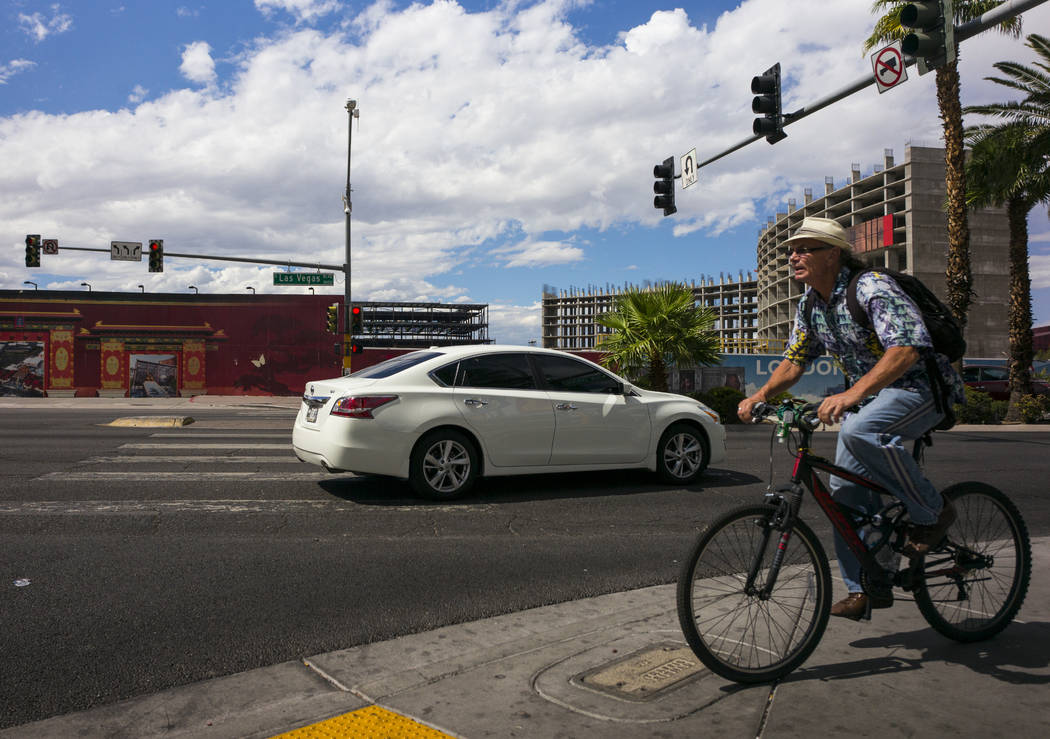A bicyclist passes by as construction continues across the street at Resorts World Las Vegas along the north Strip area in Las Vegas on Wednesday, Sept. 13, 2017. Chase Stevens Las Vegas Review-Jo ...