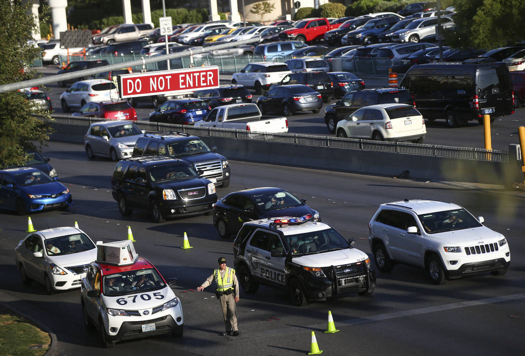 Traffic is directed along Tropicana Avenue outside of T-Mobile Arena before Saul Canelo Alvarez takes on Gennady GGG Golovkin in Las Vegas on Saturday, Sept. 16, 2017. (Chase Stevens/Las Vegas Rev ...