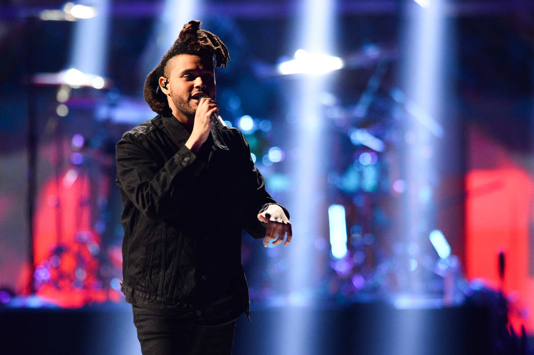 The Weeknd performs at Day 2 of the 2015 iHeartRadio Music Festival at the MGM Grand Garden Arena on Saturday, Sept. 19, 2015 in Las Vegas, Nev. (Photo by Al Powers/Powers Imagery/Invision/AP)