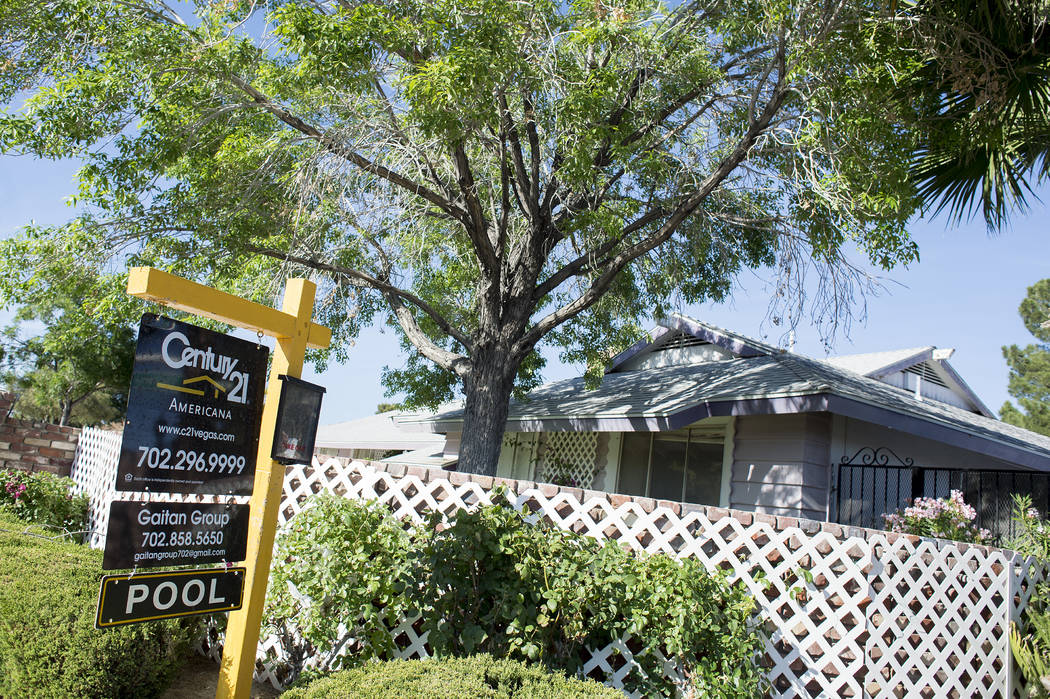 """A """"for sale"""" sign sit out front a home near the intersection of  West Washington Avenue and North Valley View Boulevard on Wednesday, May 3, 2017, in Las Vegas. Bridget Bennett L ..."""