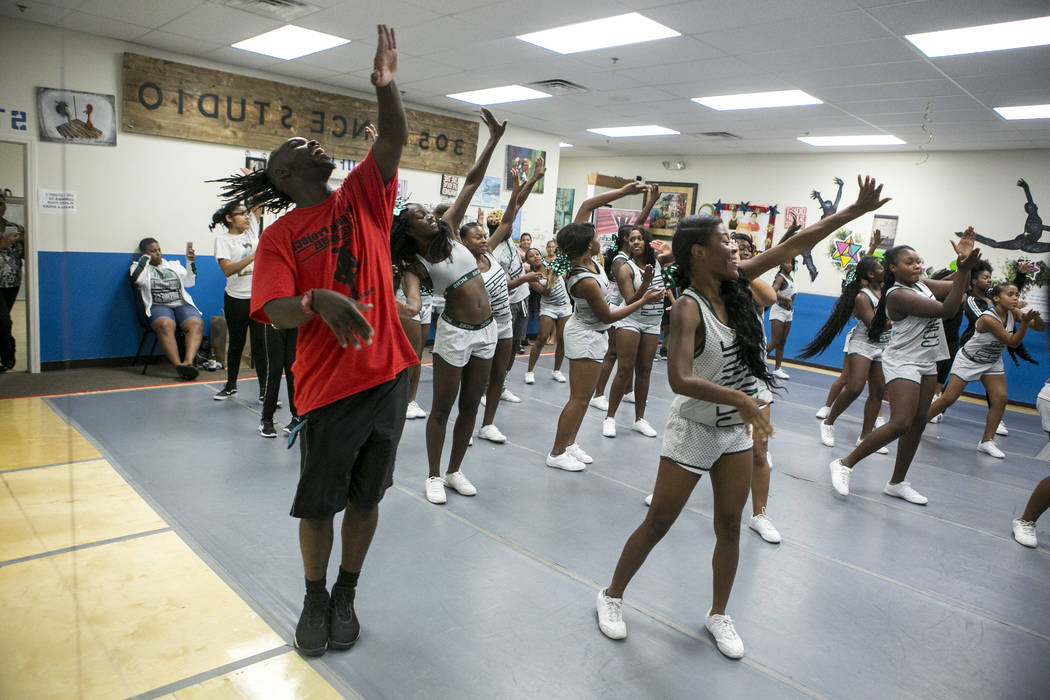 The dance studio's founder Tyrell Rolle leads Miami Central High School cheerleaders in choreography at Rolle Project on Wednesday, Sept. 13, 2017. Rolle, who is originally from Miami, held a free ...