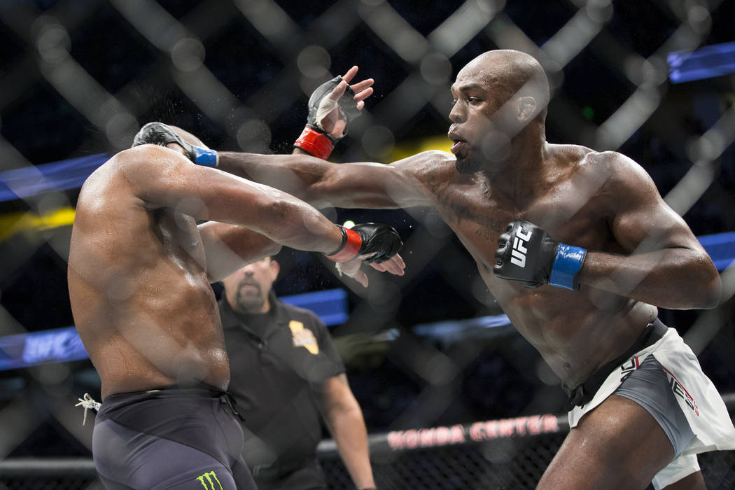 Daniel Cormier, left, battles Jon Jones in the light heavyweight title bout during UFC 214 at the Honda Center in Anaheim, Calif., on Saturday, July 29, 2017. Jones won by knockout. Erik Verduzco  ...