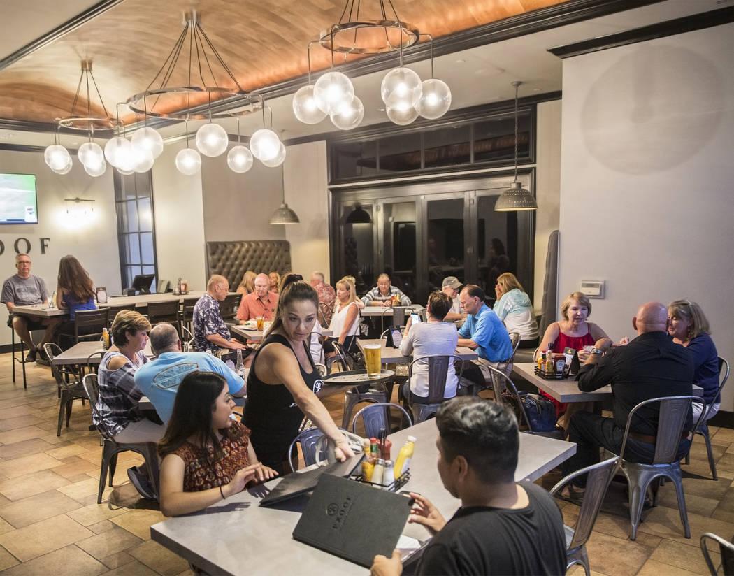 Guests enjoy dinner at Proof Tavern on Friday, September 15, 2017, in Henderson. Benjamin Hager Las Vegas Review-Journal @benjaminhphoto