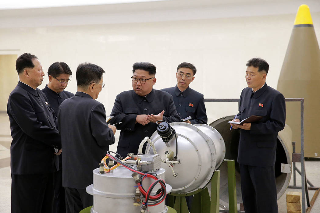 North Korean leader Kim Jong Un inspects the loading of a hydrogen bomb into a new intercontinental ballistic missile. The content of this image is provided from the North Korean government and co ...
