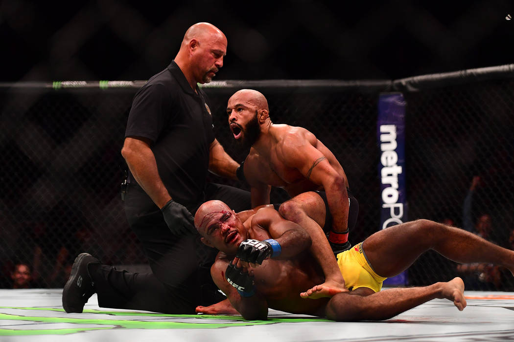 Apr 15, 2017; Kansas City, MO, USA; Demetrious Johnson (Red Gloves) and Wilson Reis (Blue Gloves) fight during UFC Fight Night at Sprint Center. Mandatory Credit: Ron Chenoy-USA TODAY Sports