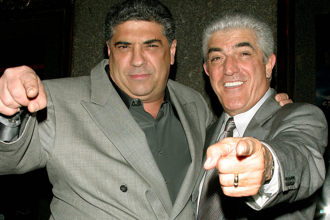 """Actors Vincent Pastore, left, and Frank Vincent point at the photographers as they arrive for the fifth season premiere of the HBO series """"The Sopranos,"""" in New York March 2, 2004. Frank Vincent h ..."""