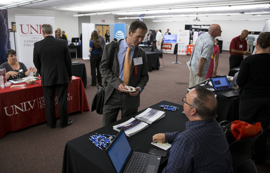 Bill Arent, left, director of economic and urban development for the City of Las Vegas, speaks with Craig Rosen, community engagement and professional development administrator for the Desert Rese ...