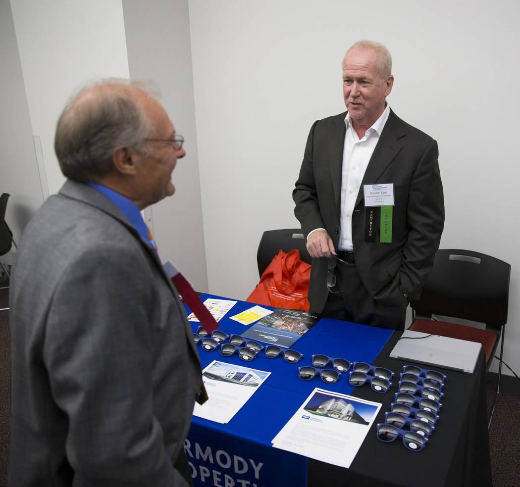 Clint Koble, left, speaks with exhibitor Brendan Egan, regional director of development for Dermody, during the Nevada Economic Development Conference in Las Vegas, Tuesday, Sept. 12, 2017. Erik V ...