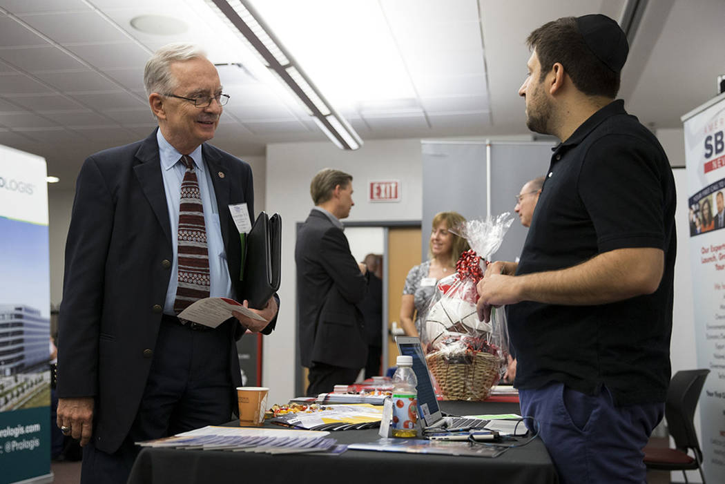 Stephen Miller, left, director of the Center for Business and Economic Research at the Lee Business School, speaks with Jake Halu of the Nevada center for Advanced Mobility, during the Nevada Econ ...