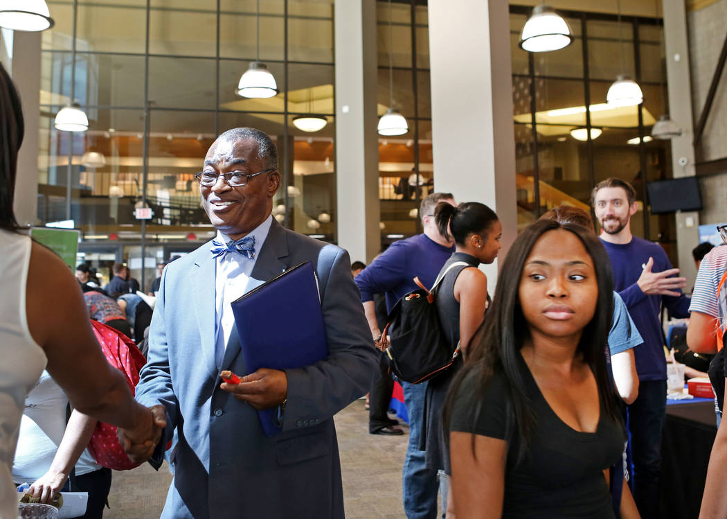 Rowland Ekechi, left, meets with the Boyd Gaming booth for placement in resource management during the College of Southern Nevada's Career Fair in North Las Vegas, Wednesday, Sept. 13, 2017. The c ...