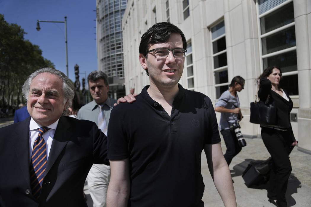 Martin Shkreli, center, leaves federal court in New York, Friday, Aug. 4, 2017. (Seth Wenig/AP)
