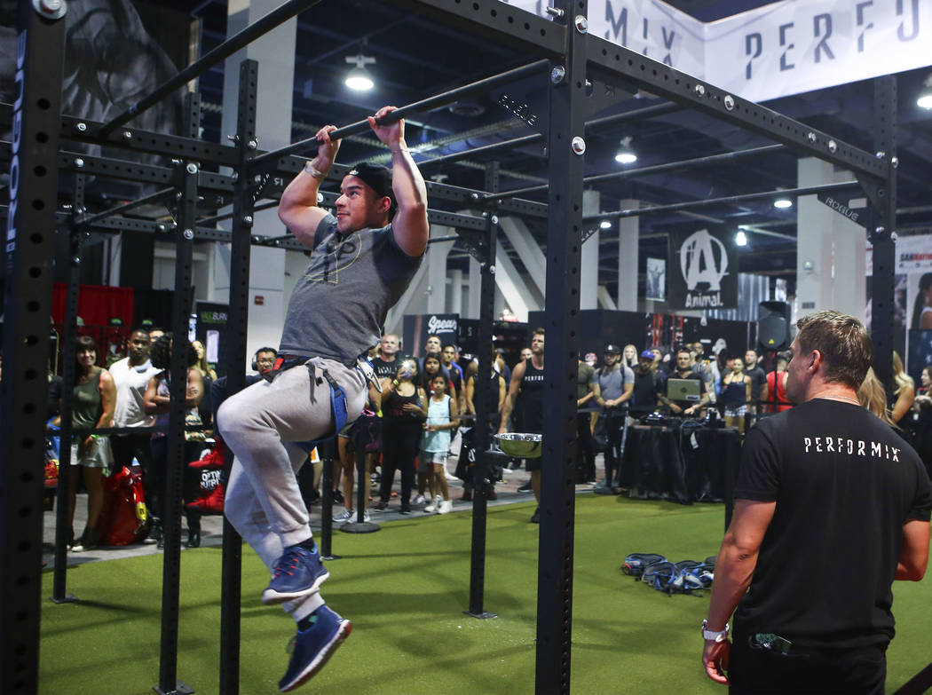 Rafael Marin of Las Vegas competes in a challenge course at the Performix booth during Joe Weider's Olympia's Fitness & Performance Expo at the Las Vegas Convention Center in Las Vegas on Frid ...