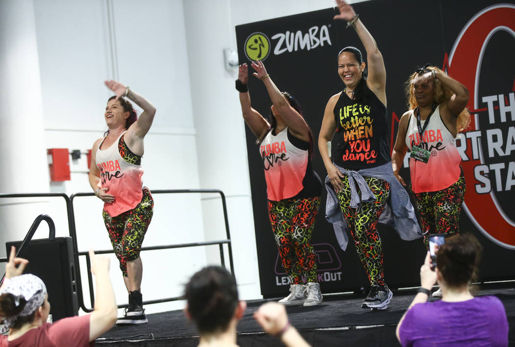Attendees participate in a Zumba workout during Joe Weider's Olympia's Fitness & Performance Expo at the Las Vegas Convention Center in Las Vegas on Friday, Sept. 15, 2017. Chase Stevens Las V ...