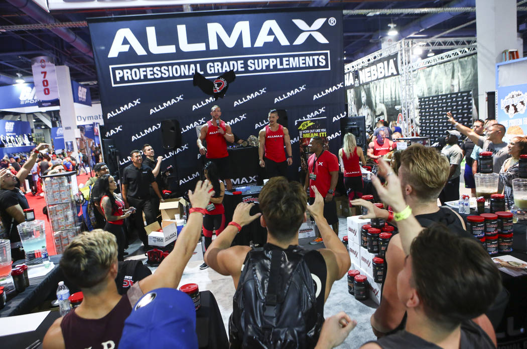 Attendees reach out for a free shirt at the Allmax booth during Joe Weider's Olympia's Fitness & Performance Expo at the Las Vegas Convention Center in Las Vegas on Friday, Sept. 15, 2017. Cha ...