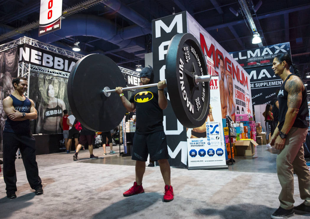 Chuck Naranjo of Las Vegas lifts a giant weight during Joe Weider's Olympia's Fitness & Performance Expo at the Las Vegas Convention Center in Las Vegas on Friday, Sept. 15, 2017. Chase Steven ...
