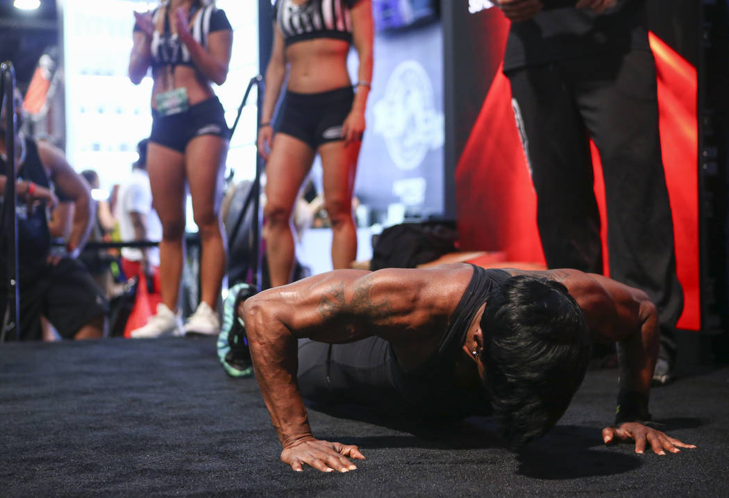 Sammica Cash competes in a push-up event during Joe Weider's Olympia's Fitness & Performance Expo at the Las Vegas Convention Center in Las Vegas on Friday, Sept. 15, 2017. Chase Stevens Las V ...
