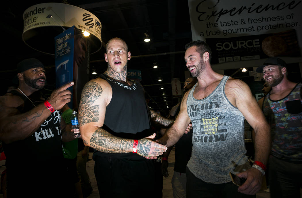 Bodybuilder and actor Martyn Ford, left, greets fans during Joe Weider's Olympia's Fitness & Performance Expo at the Las Vegas Convention Center in Las Vegas on Friday, Sept. 15, 2017. Chase S ...