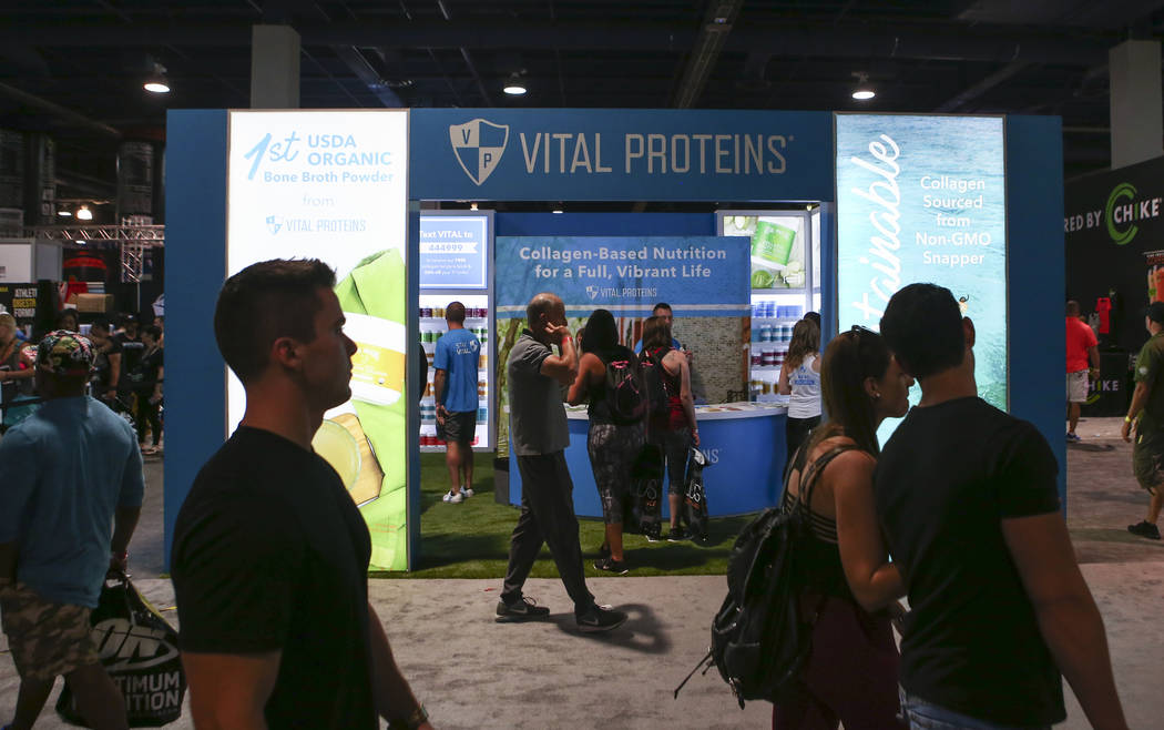 Attendees pass by the Vital Proteins booth during Joe Weider's Olympia's Fitness & Performance Expo at the Las Vegas Convention Center in Las Vegas on Friday, Sept. 15, 2017. Chase Stevens Las ...