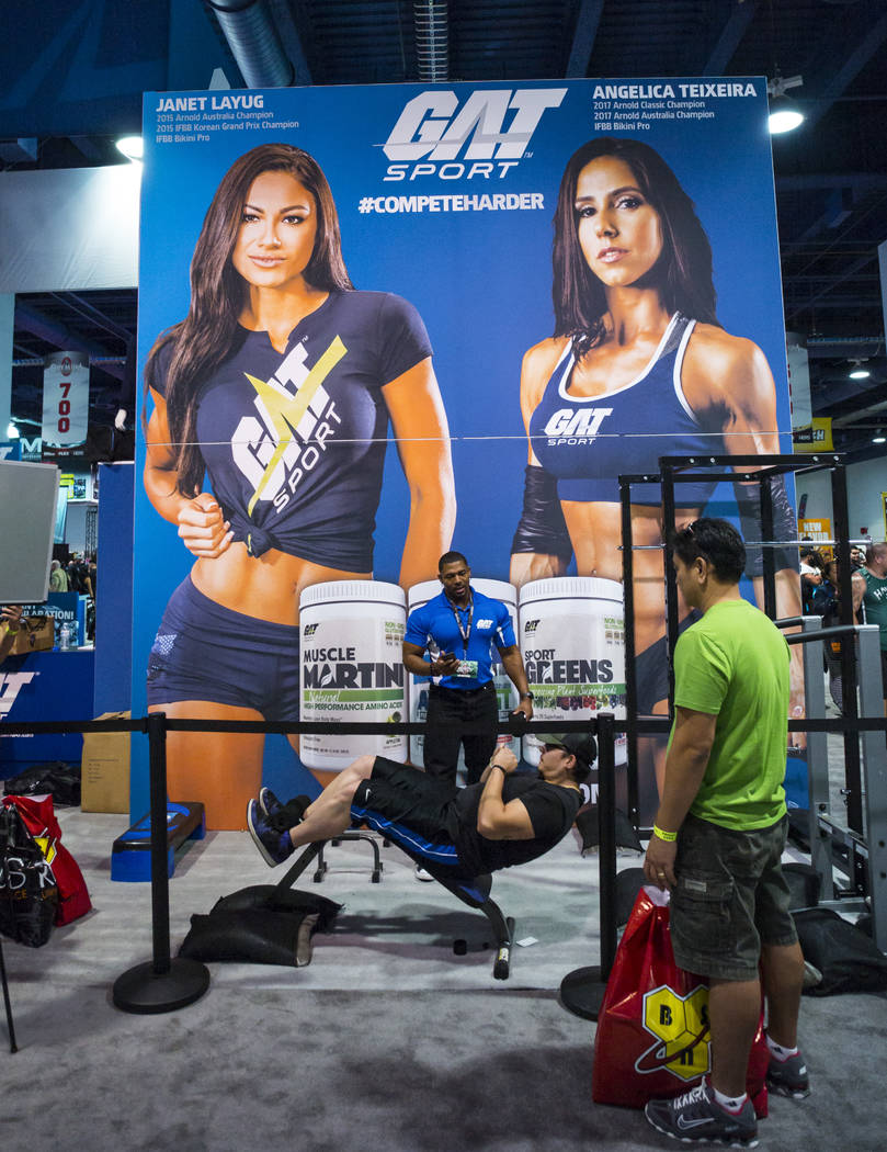 Reno Tucker of Las Vegas, lower center, works out at the GAT Sport booth during Joe Weider's Olympia's Fitness & Performance Expo at the Las Vegas Convention Center in Las Vegas on Friday, Sep ...