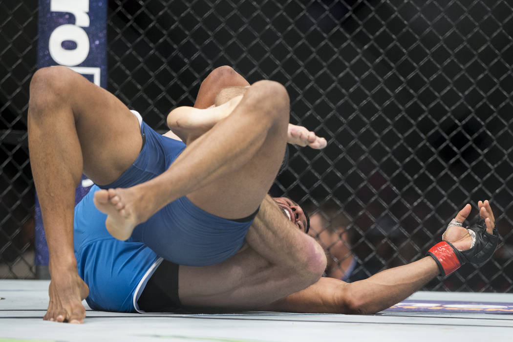 Jesse Taylor, bottom, before winning by submission against Dhiego Lima in The Ultimate Fighter 25 welterweight bout at T-Mobile Arena in Las Vegas, Friday, July 7, 2017. Erik Verduzco Las Vegas Re ...