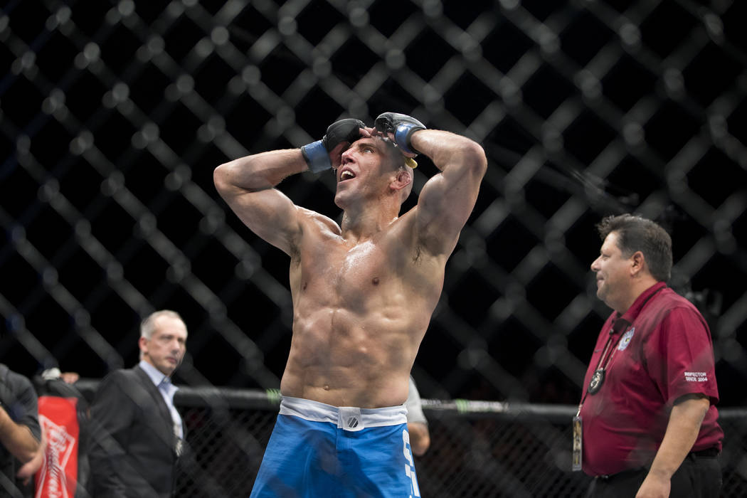 Jesse Taylor reacts to his submission win against Dhiego Lima in The Ultimate Fighter 25 welterweight bout at T-Mobile Arena in Las Vegas, Friday, July 7, 2017. Erik Verduzco Las Vegas Review-Jour ...