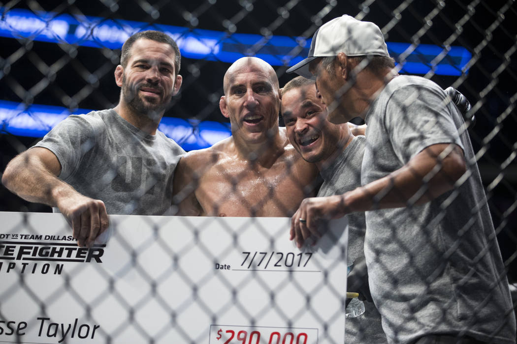 Jesse Taylor, second from left, with his team after his submission win against Dhiego Lima in The Ultimate Fighter 25 welterweight bout at T-Mobile Arena in Las Vegas, Friday, July 7, 2017. Erik V ...