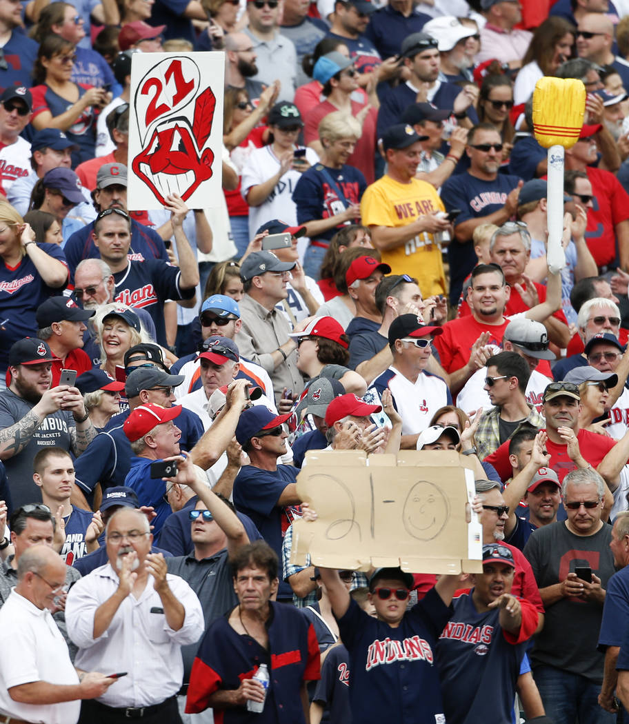 Cleveland Indians fans celebrate a 5-3 victory over the Detroit Tigers in a baseball game, Wednesday, Sept. 13, 2017, in Cleveland. The Indians set the American League record with 21 consecutive w ...