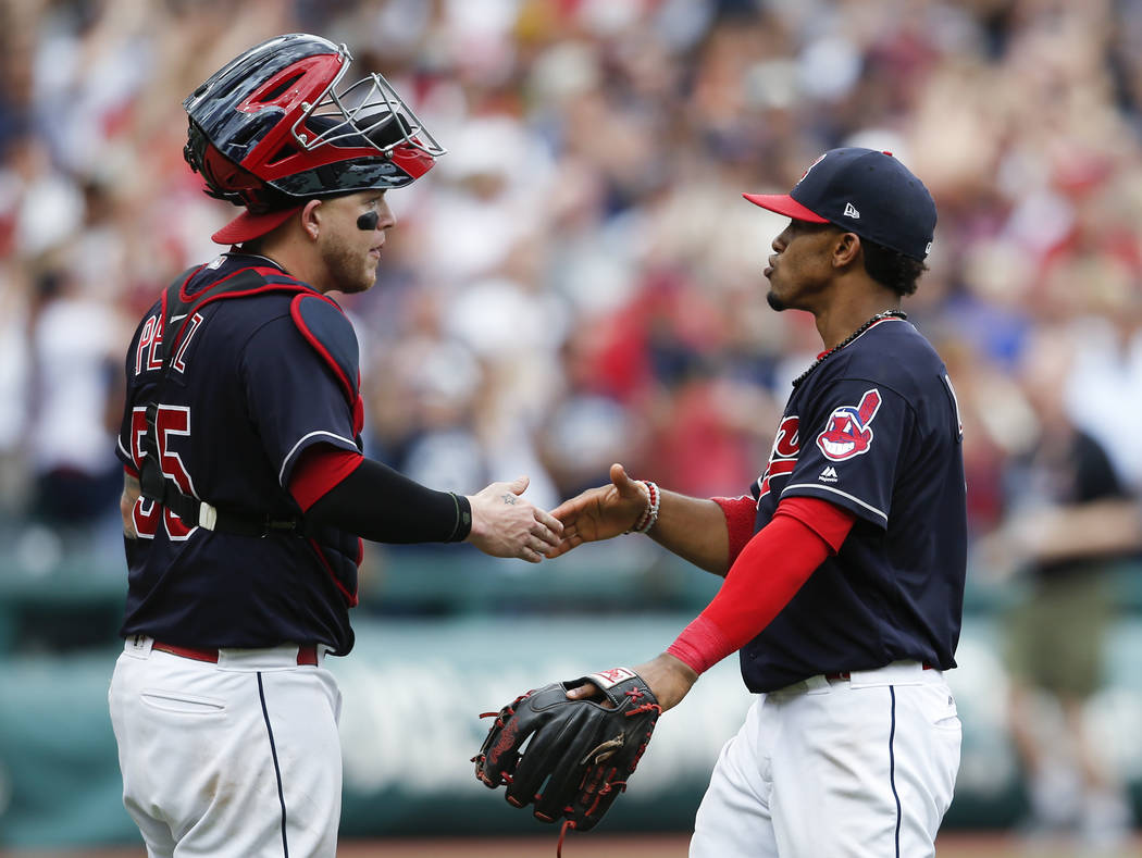 Cleveland Indians' Roberto Perez, left, and Francisco Lindor celebrate a 5-3 victory over the Detroit Tigers in a baseball game, Wednesday, Sept. 13, 2017, in Cleveland. The Indians set the Americ ...