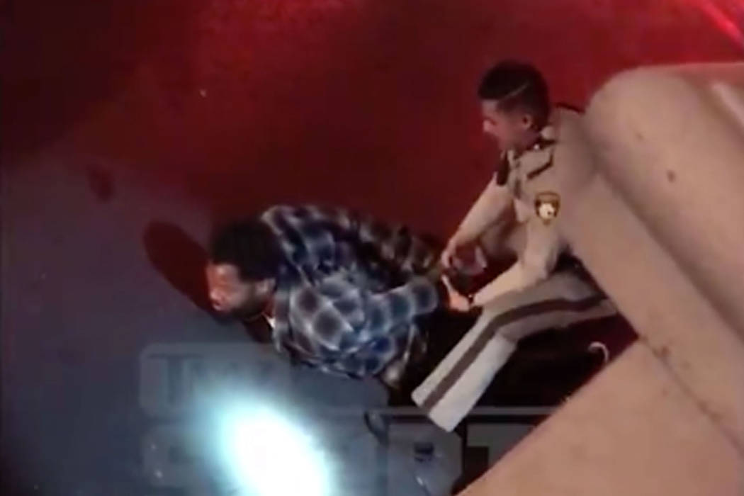 Seattle Seahawks defensive lineman Michael Bennett, left, claims Las Vegas police used excessive force and threatened to kill him on Aug. 26 after the Floyd Mayweather-Conor McGregor fight. Screen ...