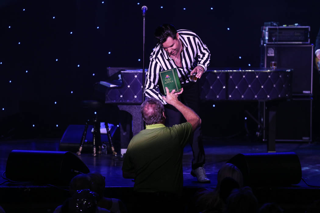 Frankie Moreno receives a bottle from a fan during a show at the Suncoast Showroom in Las Vegas, Saturday, Sept. 9, 2017. Joel Angel Juarez Las Vegas Review-Journal @jajuarezphoto