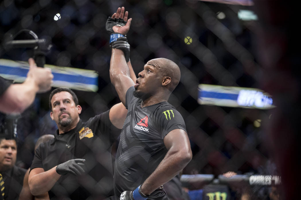 Jon Jones is announced the winner against Daniel Cormier in the light heavyweight title bout during UFC 214 at the Honda Center in Anaheim, Calif., on Saturday, July 29, 2017. Jones won by knockou ...