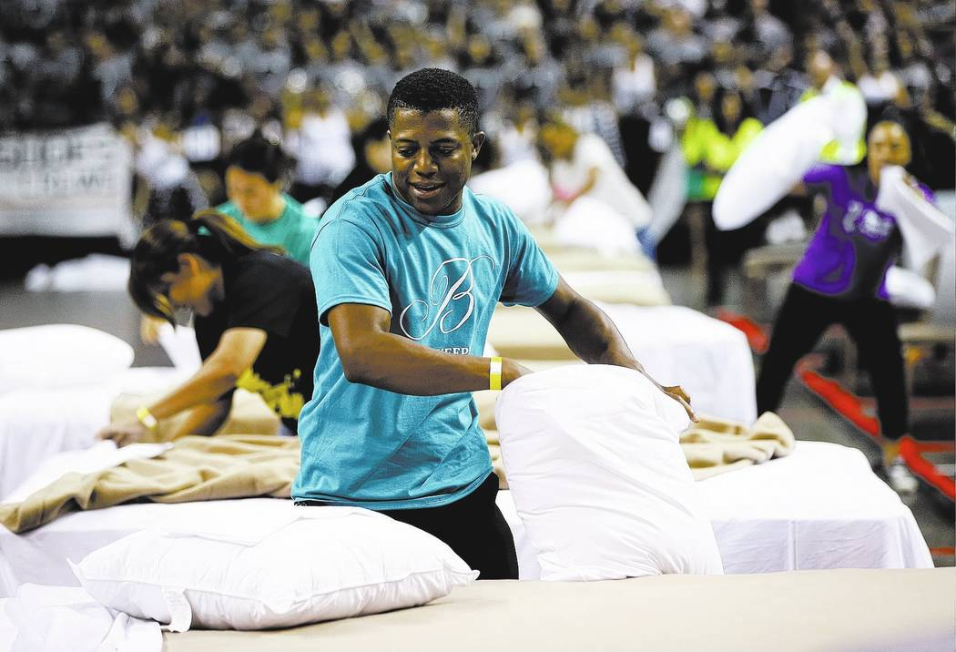 Bobby Henderson of the Bellagio competes in the bed making event during the Housekeeping Olympics at the Mandalay Bay Events Center in Las Vegas on Wednesday, Sept. 13, 2017. The competition drew  ...