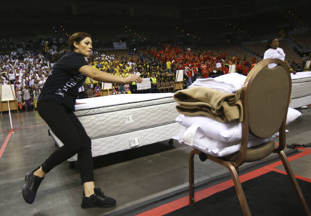 Leticia Bertin of the MGM Grand competes in the bed-making event during the Housekeeping Olympics at the Mandalay Bay Events Center in Las Vegas on Wednesday, Sept. 13, 2017. The competition drew  ...