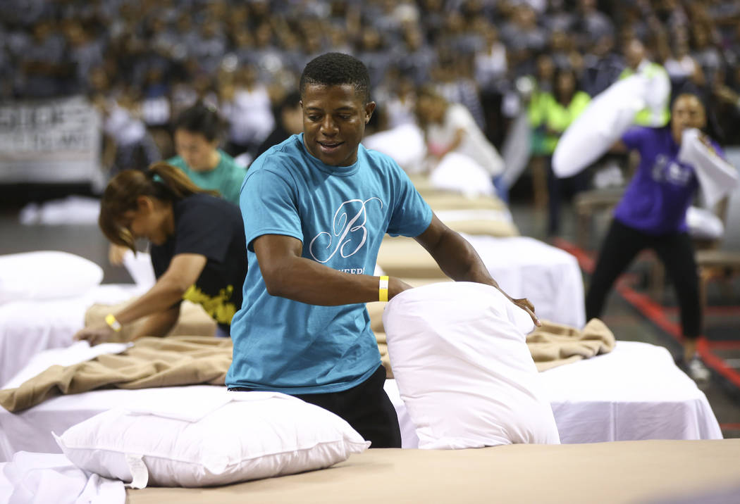 Bobby Henderson of the Bellagio competes in the bed-making event during the Housekeeping Olympics at the Mandalay Bay Events Center in Las Vegas on Wednesday, Sept. 13, 2017. The competition drew  ...
